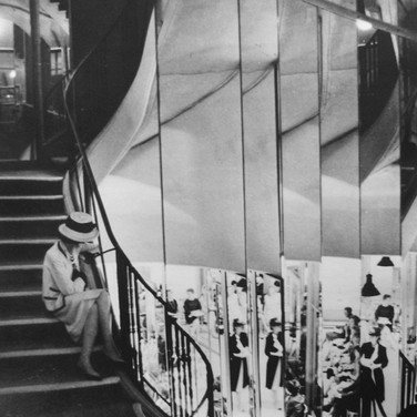 Coco Chanel on the staircase of the House of Chanel, Rue Cambon, Paris  photograph circa 1962-69 (printed later)  gelatin silver print, AP, signed  image size > 9.2 x 6.5 inches  Photograph by Hatami (1928-2017)