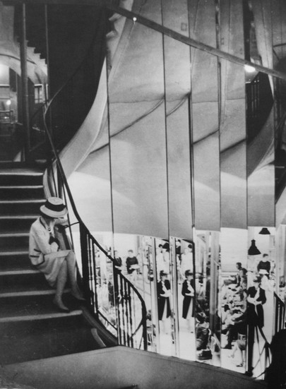Coco Chanel on the staircase of the House of Chanel, rue Cambon, Paris Photograph circa 1962-1969 (printed later) gelatin silver print, AP, signed Image Size: 12.5 x 9.75 inches   31.8 x 24.8 cm Paper Size: 14 x 11 inches   35.6 x 27.9 cm  Photograph by Hatami (1928-2017)
