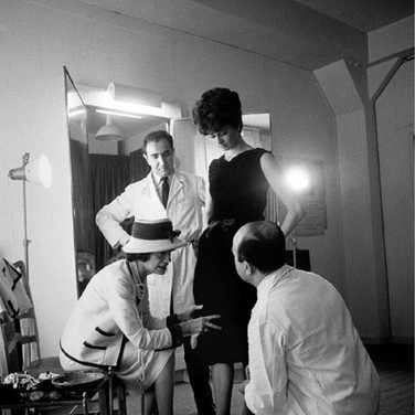 Douglas Kirkland  Mlle Chanel with fitter Jean and staff in the Atelier, House of Chanel  1962 [printed later]  archival pigment print, edition of 24, signed  paper size > 24 x 20 inches