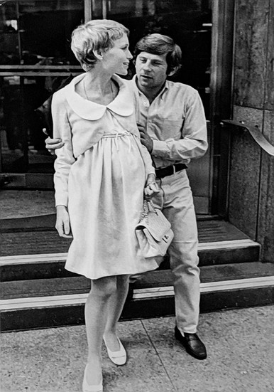 """Roman Polanski and Mia Farrow in front of The Dakota Building, New York City, on the set of """"Rosemary's Baby,"""" 1968 vintage gelatin silver print, signed, stamped Image Size: 14.5 x 9.25 inches   36.8 x 23.5 cm  Photograph by Hatami (1928-2017)"""