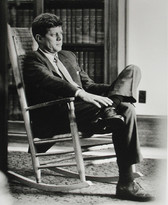 Black & white photograph of Senator Kennedy in an armchair