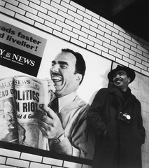Roy Schatt poses next to his image in a subway ad in New York City, 1954