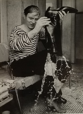 Bob Adelman (1930-2016)  Andy Warhol empties his boots after being pushed into the pool by Edie Sedgwick, Al Roon's Gym, NYC photograph 1965 (printed later) unique, vintage gelatin silver print signed and stamped on verso image size > 6 x 8.5 inches paper size > 11 x 14 inches