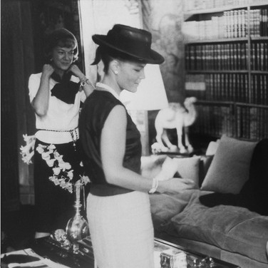 Romy Schneider and Coco Chanel in Chanel's private apartment, House of Chanel  photograph circa 1962-1969 (printed later)  gelatin silver print, AP, signed  image size > 9.5 x 14.25 inches  Photograph by Hatami (1928-2017)