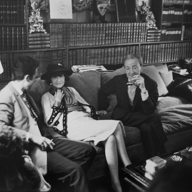 Coco Chanel with guests in her private apartment, House of Chanel  photograph circa 1962-1969 (printed later)  gelatin silver print, AP, signed image size > 9.5 x 14.25 inches  Photograph by Hatami (1928-2017)