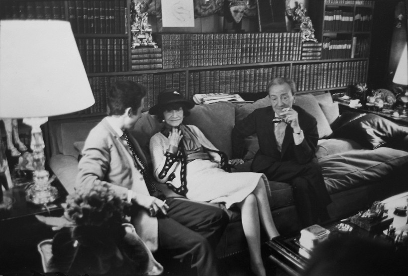 Coco Chanel with Guests in her Private Apartment, House of Chanel, rue Cambon, Paris Photograph circa 1962 (printed later) gelatin silver print, AP, signed Image Size: 9.5 x 14.5 inches   24.1 x 36.8 cm Paper Size: 12 x 16 inches   30.5 x 40.6 cm  Photograph by Hatami (1928-2017)