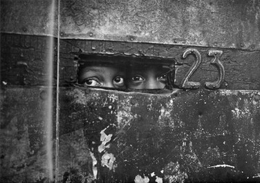 BOB ADELMAN (1931-2016) Peering through a mail slot, Brooklyn, New York City photo 1964 [printed later]  gelatin silver print, edition of 15, signed, numbered  paper size > 16 x 20 inches
