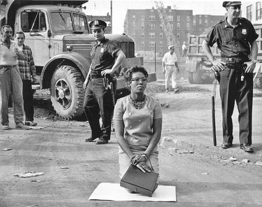 BOB ADELMAN (1931-2016) Protestors put their lives on the line, closing down a construction site at the Downstate Medical Center, Brooklyn, New York City photo 1963 [printed later]  gelatin silver print, edition of 15, signed, numbered  paper size > 16 x 20 inches