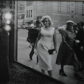 Sam Shaw [1912-1999]  Marilyn Monroe on Fifth Avenue, NYC  photo 1957 [printed later],  gelatin silver print, AP, stamped by the Estate paper size > 15 x 19 inches