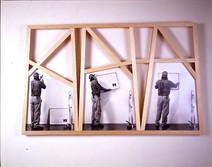 Irregular wood frame showing three photographs of a man hanging a Baldessari artwork