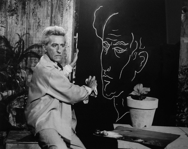 Lucien Clergue [1934-2014]  Jean Cocteau and His Self-Portrait photo  1959 [printed later]  gelatin silver print, edition of 30, signed Paper Size: 20 x 16 inches   50.8 x 40.6 cm