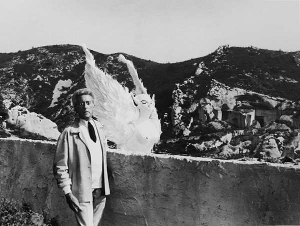 Lucien Clergue [1934-2014]  Jean Cocteau as The Poet and the Sphinx, Testament of Orpheus, Les Baux de Provence  photo 1959 [printed later]  gelatin silver print, edition of 30 PF, signed  Paper Size: 11.5 x 15.25 inches   30.5 x 40.6 cm Image Size: 10.25 x 13.75 inches   26.0 x 34.9 cm