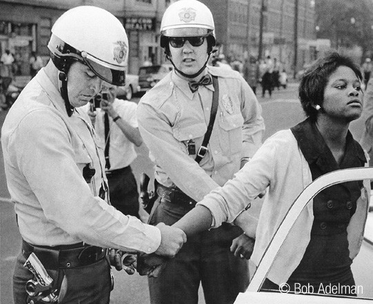 BOB ADELMAN (1930-2016) Innocent bystander arrested, Birmingham, Alabama photo 1963 [printed later]  gelatin silver print, edition of 15, signed, numbered  Paper Size: 16 x 20 inches | 40.6 x 50.8 cm