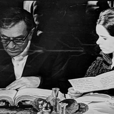 """Photograph by Hatami (1928-2017) Geraldine Chaplin and director David Lean reviewing the script, on the set of """"Doctor Zhivago"""" photograph 1965 vintage gelatin silver print, signed, stamped 8 x 11.5 inches"""