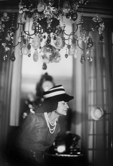 Coco Chanel in her private apartment, House of Chanel, rue Cambon, Paris Photograph circa 1960s (printed later) gelatin silver print, AP, signed Image Size: 14.5 x 9.5 inches   36.8 x 24.1 cm Paper Size: 16 x 12 inches   40.6 x 30.5 cm  Photograph by Hatami (1928-2017)