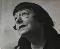 Dorothy Parker poses staring up and left, 1955