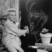 Lucien Clergue [1934-2014]  Jean Cocteau and His Self-Portrait  photo 1959 [printed later]  gelatin silver print, edition of 30, signed  paper size > 20 x 16 inches