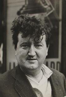 Brendan Behan poses staring at the camera in Paris, 1959
