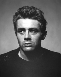 James Dean looks left in a torn sweater in New York City