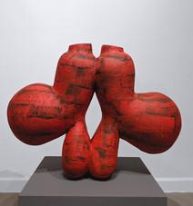"""Black and red bulbous papier-mache sculpture, """"Fat Dog,"""" 2003"""