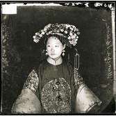 John Thomson (1837-1931)  Manchu Bride, Peking  photograph circa 1871-1872 [printed later]  gelatin silver print, edition of 350  16 x 20 inches, stamped