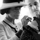 Douglas Kirkland  Mlle Chanel with fitter Jean and staff in the Atelier, House of Chanel  1962 [printed later]  archival pigment print, edition of 24, signed  paper size > 20 x 24 inches