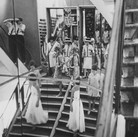 Douglas Kirkland  Mlle Chanel with models on the staircase of the House of Chanel  1962 [printed later]  archival pigment print, edition of 24, signed  paper size > 24 x 20 inches