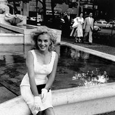 Sam Shaw [1912-1999]  Marilyn Monroe at the Plaza Fountain, New York City  photo 1954 [printed later]  c-print, AP, stamped by the Estate paper size > 16.5 x 11.5 inches