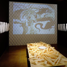 """Nobuho Nagasawa Orient-a-tion, 1995 cast soap, traditional doll material, wood, water, video projector, baby powder scent  From """"A Gathering Place: Art Making by Asian/Pacific Rim Women,"""" Pacific Asian Museum, Pasadena, California, 1995"""