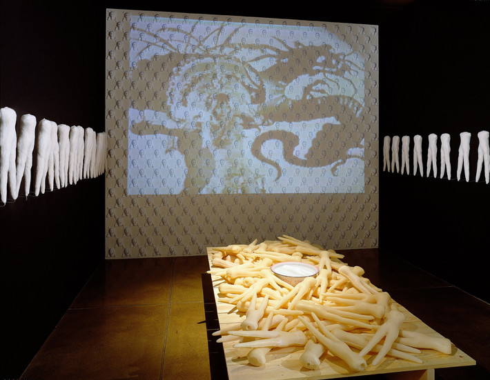 """NOBUHO NAGASAWA Orient-a-tion (1995) cast soap, traditional doll material, wood, water, video projector, baby powder scent  Installation from """"A Gathering Place: Art Making by Asian/Pacific Rim Women"""" at Pacific Asian Museum, Pasadena, California, 1995."""