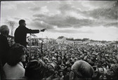 Black & white photograph of Senator Kennedy speaking to a crowd