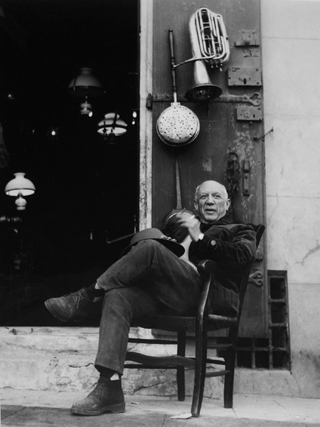 Lucien Clergue [1934-2014]  Picasso in front of an antiques store, Arles  photo 1965 [printed later]  gelatin silver print, edition of 30 MF, signed  Paper Size: 20 x 16 inches   50.8 x 40.6 cm Image Size: 17.5 x 13.75 inches   44.5 x 34.9 cm