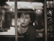Maureen Stapleton looks left out of a window in New York City, 1960s