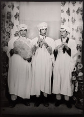 1960s black & white photograph of three men in middle-eastern garb with music instruments in a photography studio