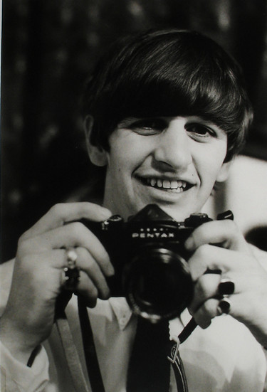 Ringo Starr with his camera, February 1964 vintage gelatin silver print Image Size: 11 x 7.25 inches   27.9 x 18.4 cm  Photography by Hatami (1928-2017)