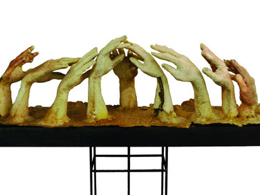 JOAN GIORDANO  Farm Hands  2004  cast paper encaustic wax  14 x 11 x 52 inches