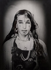 1960s black & white portrait of Amazigh woman with facial tattoos, wearing pearls, in a photography studio