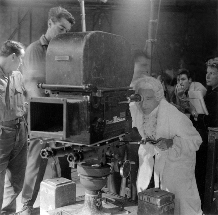 Lucien Clergue [1934-2014] Jean Cocteau in Louis XV costume operating the camera on the set of Testament of Orpheus, Nice, Les Baux de Provence photo 1959 [printed 2001] gelatin silver print, edition of 30 PF, signed Paper Size: 11.25 x 15.5 inches | 28.6 x 39.4 cm Image Size: 9.75 x 9.75 inches | 24.8 x 24.8 cm