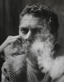 Steve McQueen smoking in Roy Schatt's studio in New York City, 1950s