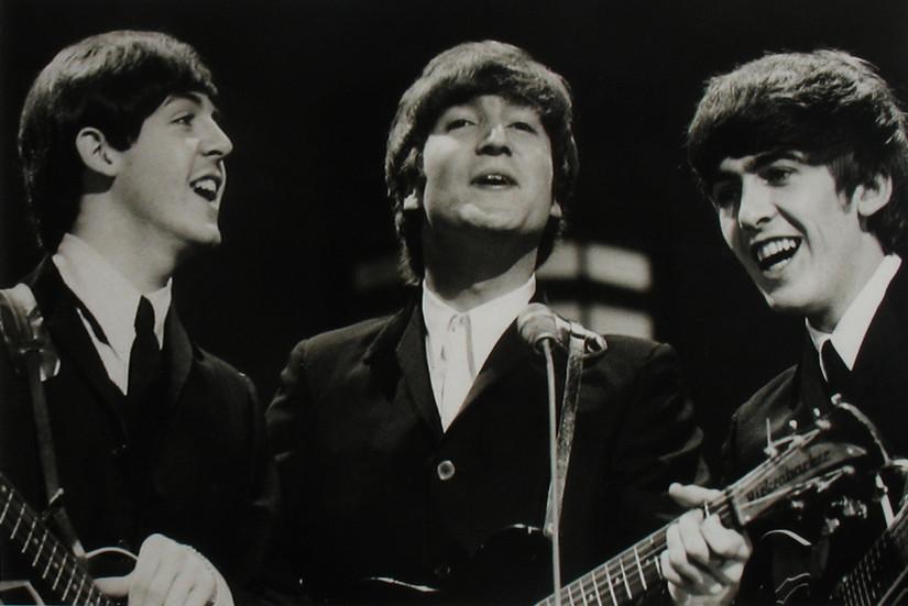 Paul McCartney, John Lennon, George Harrison at the Ed Sullivan Show, February, 1964 vintage gelatin silver print Image Size: 7.25 x 11.25 inches   18.4 x 28.6 cm  Photography by Hatami (1928-2017)