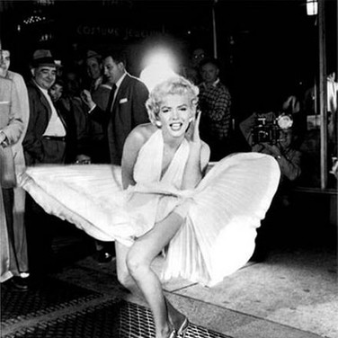 "SAM SHAW [1912-1999]  Marilyn Monroe during the filming of ""The Seven Year Itch"" in New York City  photo 1954 [printed later]  gelatin silver print, AP, stamped by the Estate paper size > 19 x 15 inches"