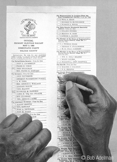 BOB ADELMAN (1930-2016) One of the first African American voters to cast a vote under the new law, Camden, Alabama photo 1966 [printed later]  gelatin silver print, edition of 15, signed, numbered Paper Size: 20 x 16 inches | 50.8 x 40.6 cm