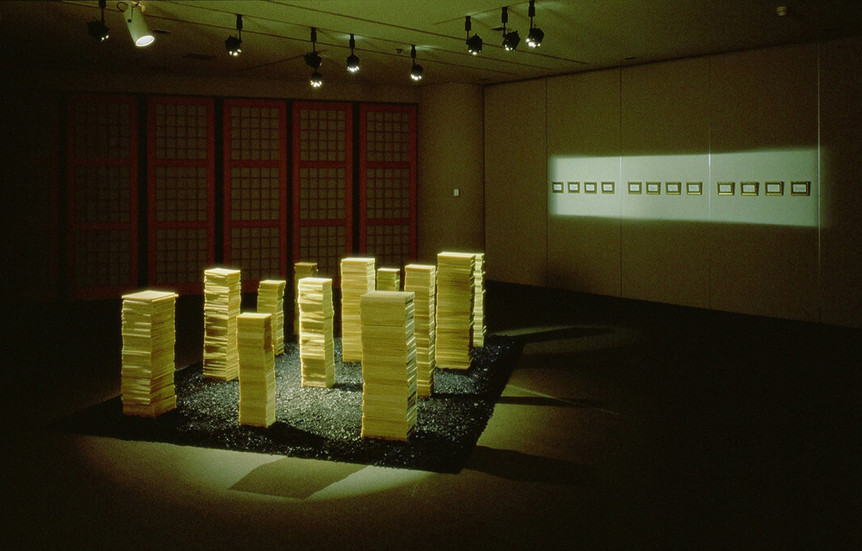 """NOBUHO NAGASAWA Celsius 233 (1996) wax, coal, library card catalogue, picture frame dimensions variable  Installation from """"Origin and Myths of Fire: New Art from Japan, China, and Korea"""" at The Museum of Modern Art, Saitama, Japan, 1996."""