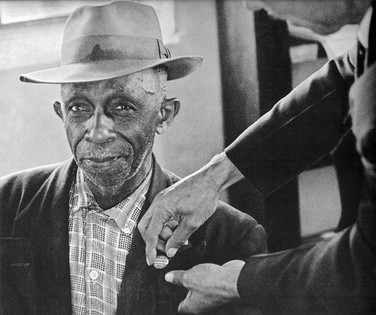 BOB ADELMAN (1931-2016) A successfully registered voter is awarded with his button, Sumter, South Carolina photo 1962 [printed later]  gelatin silver print, edition of 15, signed, numbered  paper size > 16 x 20 inches