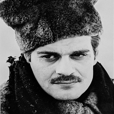 """Photograph by Hatami (1928-2017) Omar Sharif in a winter scene in the Ural Mountains, on the set of """"Doctor Zhivago"""" photograph 1965 vintage gelatin silver print, signed, stamped 9 x 6 inches"""