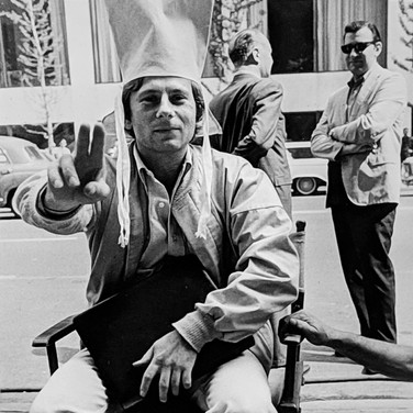 """Photograph by Hatami (1928-2017) Roman Polanski taking a break between takes, on the set of """"Rosemary's Baby"""" photograph 1968 vintage gelatin silver print, signed, stamped 10.5 x 8 inches"""
