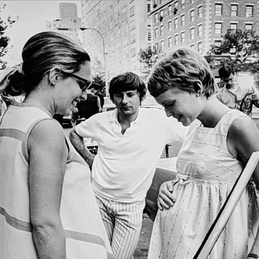"""Photograph by Hatami (1928-2017) Roman Polanski directing Mia Farrow on Madison Avenue, New York City, on the set of """"Rosemary's Baby"""" photograph 1968 vintage gelatin silver print, signed, stamped 11 x 7 inches"""