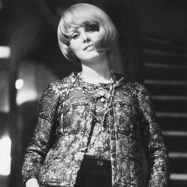 Catherine Deneuve wearing Chanel on the circular staircase of the House of Chanel  photograph circa 1962-1969 (printed later)  gelatin silver print, AP, signed  image size > 14.5 x 9 inches  Photograph by Hatami (1928-2017)