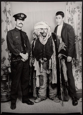 1960s black & white photograph of three men (one in middle-eastern garb) in a photography studio