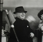 """Sophia Loren and Charlie Chaplin on the set of """"A Countess from Hong Kong,"""" 1966  Pinewood Studios, Buckinghamshire  vintage gelatin silver print image size > 14.5 x 9.5 inches  Photograph by Hatami (1928-2017)"""